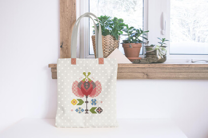 Colorful modern spring flowers cross stitch pattern on shopping bag