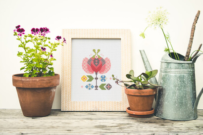 Colorful modern spring flowers cross stitch pattern in frame