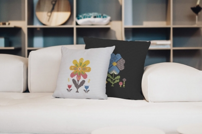 Colorful modern spring flowers cross stitch pattern on two pillowcases