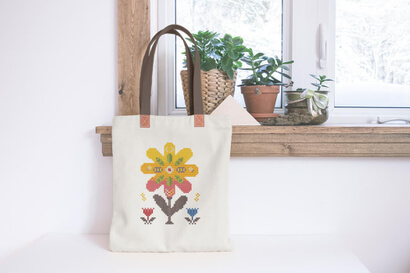 Colorful modern spring flowers cross stitch pattern on tote bag