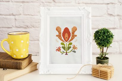 Colorful modern summer flowers cross stitch pattern in small white frame