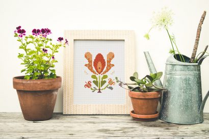 Colorful modern summer flowers cross stitch pattern in frame