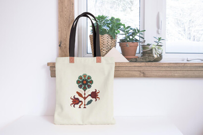 Colorful modern autumn flowers cross stitch pattern on shopping bag