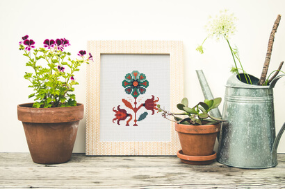Colorful modern autumn flowers cross stitch pattern in frame