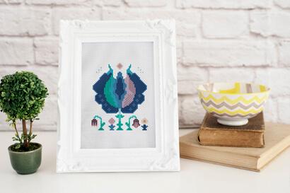 Colorful modern winter flowers cross stitch pattern in frame