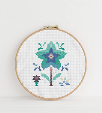 Colorful modern winter flowers cross stitch pattern in embroidery hoop