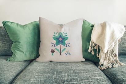 Colorful modern winter flowers cross stitch pattern on pillowcase