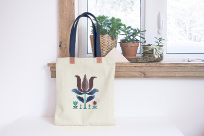 Colorful modern winter flowers cross stitch pattern on shopping bag