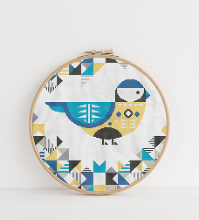 Geometric Birds: blue chickadee cross stitch pattern in embroidery hoop