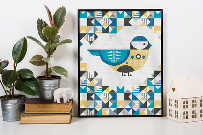 Geometric Birds: blue chickadee cross stitch pattern in frame