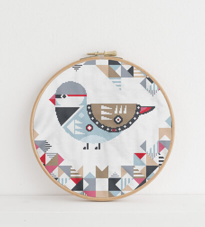 Geometric Birds: diamond firetail cross stitch pattern in embroidery hoop