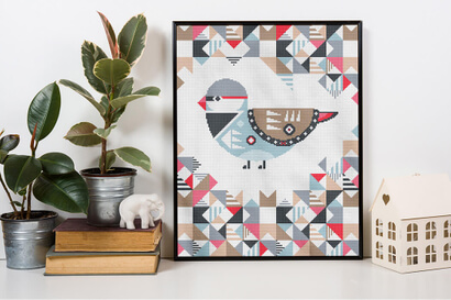 Geometric Birds: diamond firetail cross stitch pattern in frame