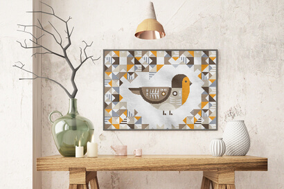 Geometric Birds: european robin cross stitch pattern in large frame over rustic table