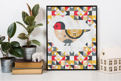 Geometric Birds: house finch cross stitch pattern in frame