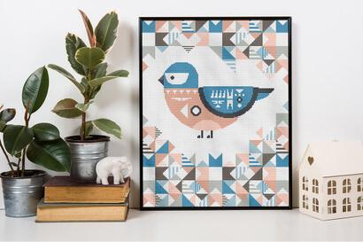 Geometric Birds: eastern bluebird cross stitch pattern in frame