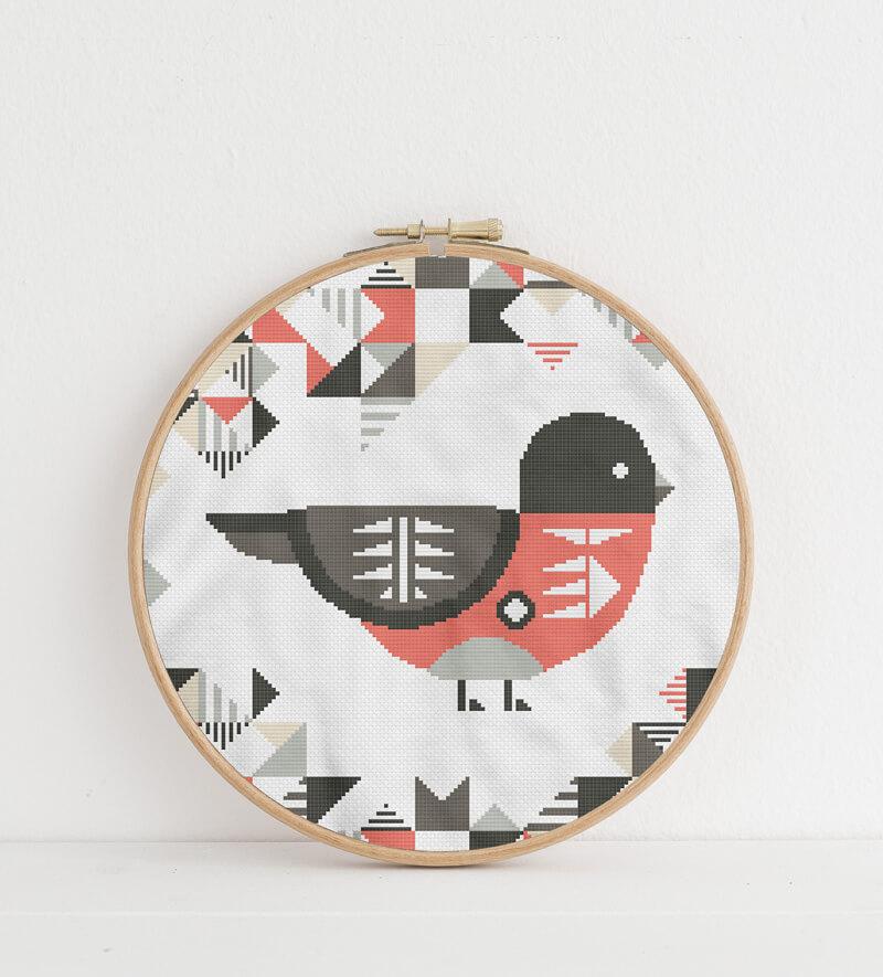 Geometric Birds: scarlet robin cross stitch pattern in embroidery hoop