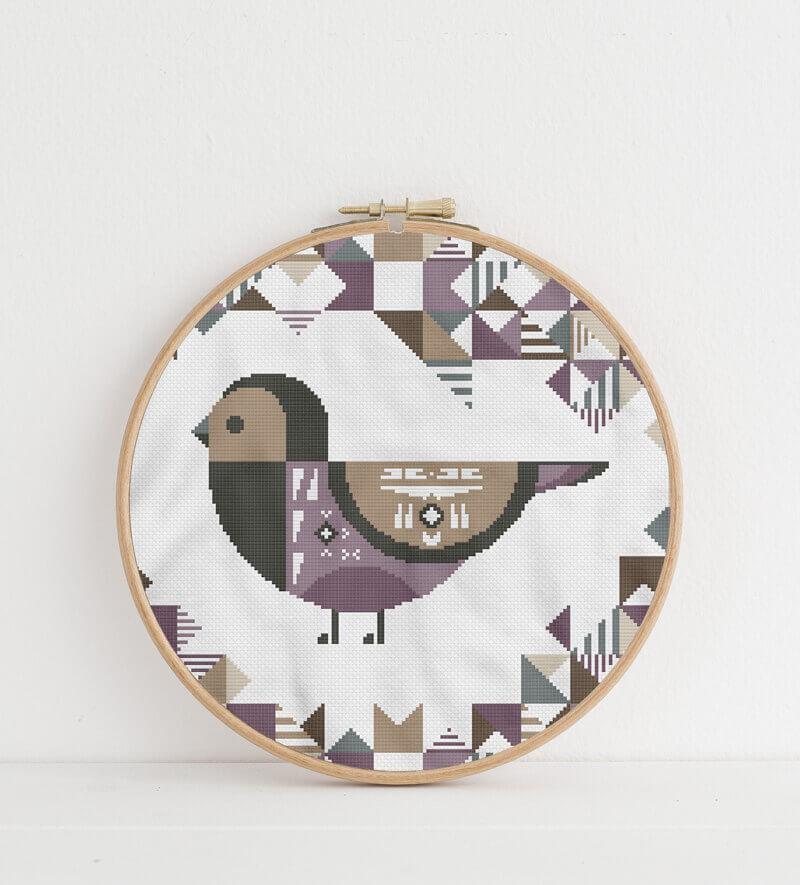 Geometric Birds: purple grenadier cross stitch pattern in embroidery hoop